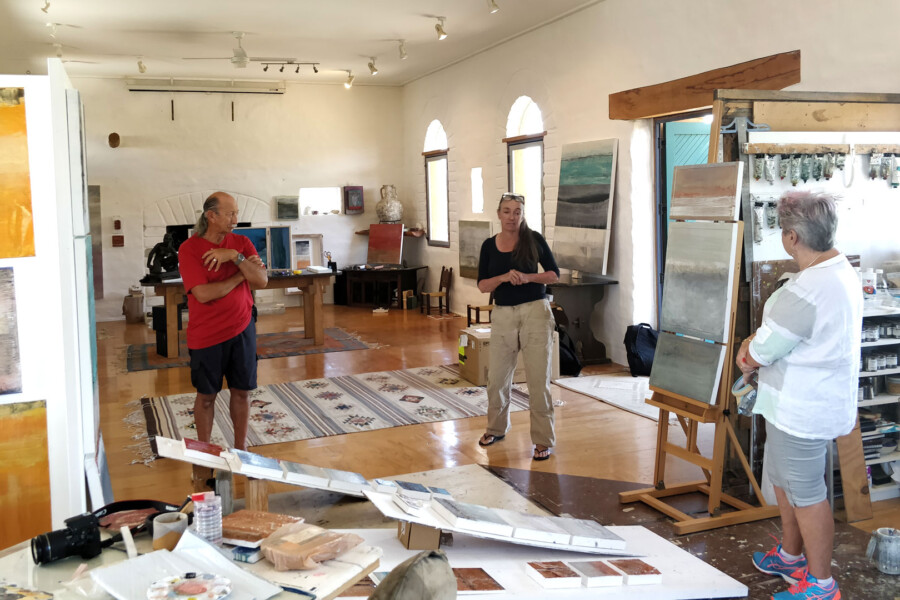 Gabriella Lewenz, Waiheke Island painter, with visitors at her studio
